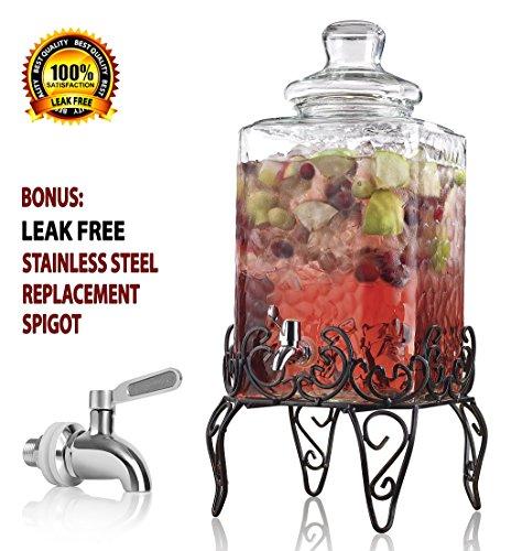 elegant hammered glass beverage dispenser with scroll iron