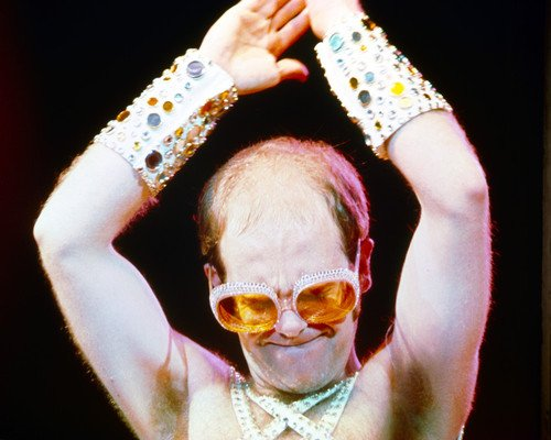 Elton John classic sunglasses and sleeveless outfit iconic 8x10 Promotional Photograp