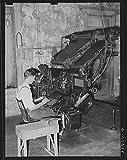 Linotype operator. Newspaper office. San Augustine, Texas