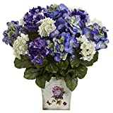 Appropriately bright and cheerful for any occasion, these bright Mixed Hydrangea flowers possess vivid gorgeous, multi-colored blooms that are sure to please. The pretty flowers are arranged within a large encasement of bright green leaves an...