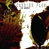 In Waste by Carrier Flux