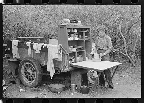 (Two-wheeled trailer with kitchen cabinet fitted on the end. This is copied from the old chuck wagons. Harlingen, Texas migrant camp)
