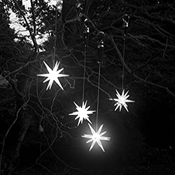 Amazon single 4 inches frosted starburst outdoor lighted single 4 inches frosted starburst outdoor lighted ornament bright white led with timer aloadofball Choice Image