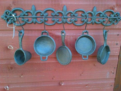 De hierro fundido para colgar sartenes y ollas de cocina de pared diseño de diseño: Amazon.es: Hogar