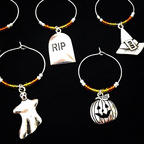 Halloween Theme Wine Charms, Halloween Gift. Witch, Jack-o-lantern, Bat, Ghost, Skull and crossbones. Set of 8. CANDY CORN BEADS.]()
