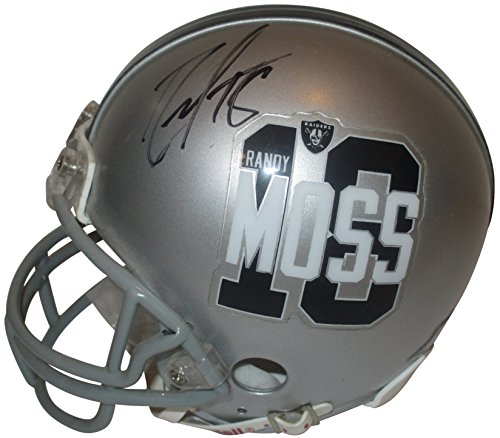 - Oakland Raiders Randy Moss Autographed Hand Signed Riddell Moss 18 Mini Football Helmet with Proof Photo of Signing and COA
