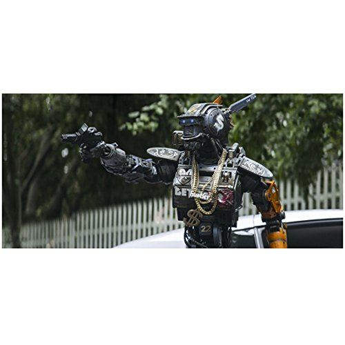 Chappie Aiming Weapon While Wearing Gold Chains with