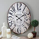 Our distressed white oval clock will add shabby chic charm to any space. Resembling repurposed wood from an old farmhouse table or potting stand our Paris clock exudes the feel of rustic sophistication. With the ornate numbers and black and w...