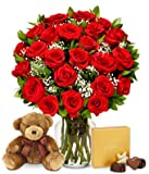 Create a moment to treasure by sending our velvety red roses. This garden-fresh bouquet arrives with a box of chocolates and a cuddly teddy bear. The ultimate gift to proclaim your love and dedication! Order today for next day delivery. Inclu...