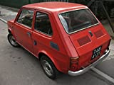 Red Polski Fiat 126p produced between 1973 and 1978 in KrakÌ_w.