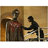 Bones Tamara Taylor as Dr. Camille Saroyan Standing on Lift Gathering Blood Swab Off Lincoln Statue in Museum 8 x 10 Photo