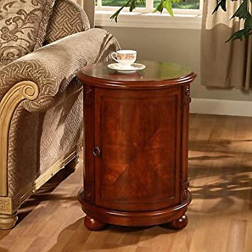 Birch Drum Table. This Decorative Accent table Features a Storage Area with Two Shelves and Antique Handle. With it s wine barrel table Shape It gives Maximum Room for your Stored Items Like Other End Tables and Coffee Tables, It Looks great next to Living Room Furniture Like Sofas. But Also Works well with Your Other Home Furnishings Like Next to Beds Or Wall Mounted Mirrors.