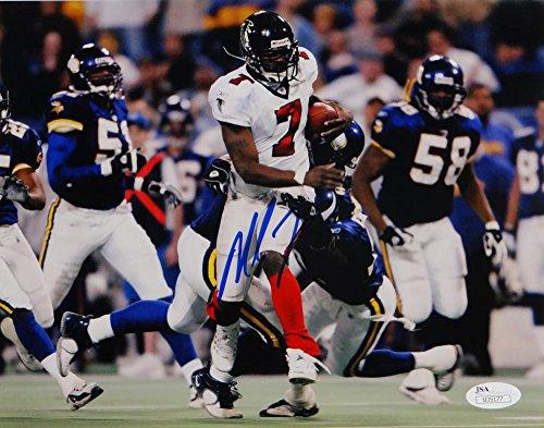 (Michael Vick Autographed Atlanta Falcons 8x10 Avoiding Tackle Photo- JSA Auth Blue)