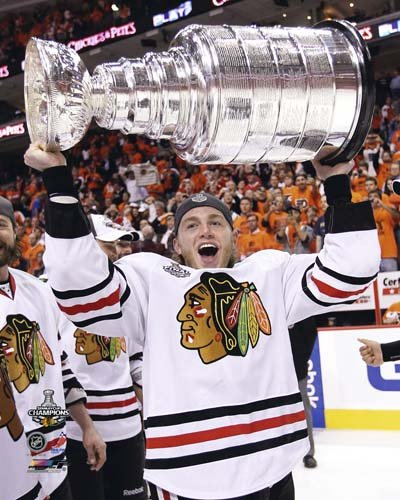 Patrick Kane Chicago Blackhawks NHL 8x10 Photograph with 2010 Stanley Cup Trophy