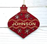"This Christmas ornament is made from red stained clear coat finished maple wood. Create a keepsake with an engraved name and year. Make a memorable gift that your family or friends will love this Christmas. The ornament is approximately 4"" in diamete..."