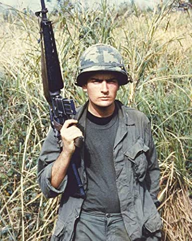 Martin Sheen in Apocalypse Now in Vietnam jungle holding machine gun