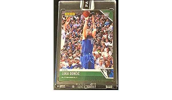 c878803b9 Amazon.com  Rare LUKA DONCIC Rookie Basketball Card - Only 10 Produced! -  2019 Panini Instant GREEN - Depicts His 7th Triple Double - No. 77 Records  No. 7!