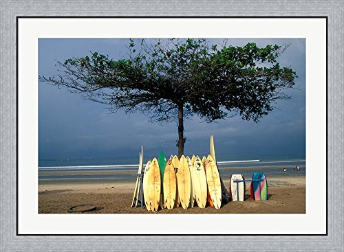 Surfboards Lean Against Lone Tree on Beach in Kuta, Bali, Indonesia by Paul Souders / Danita Delimont Framed Art Print Wall Picture, Flat Silver Frame, 39 x 28 inches by Great Art Now