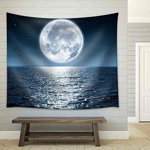 Full Moon Rising Over The Ocean Empty at Night with Copy Space Fabric Wall