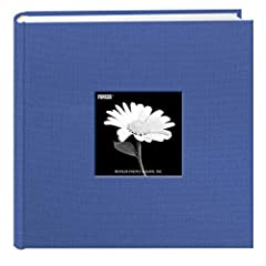 This fabric cover photo album features a frame to insert a favorite photo and a deluxe rounded bookbound spine. The album's patented Bi-Directional pockets hold horizontal or vertical photos up to 4 x 6 inches. There is a memo writing area ne...
