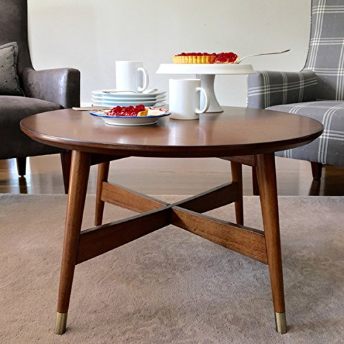 Mid-Century, Transitional Round Coffee Table with Warm Walnut Finish - 3184475. Tapered Legs Capped with Brass Finished Brackets Accent Table. Assembly Required