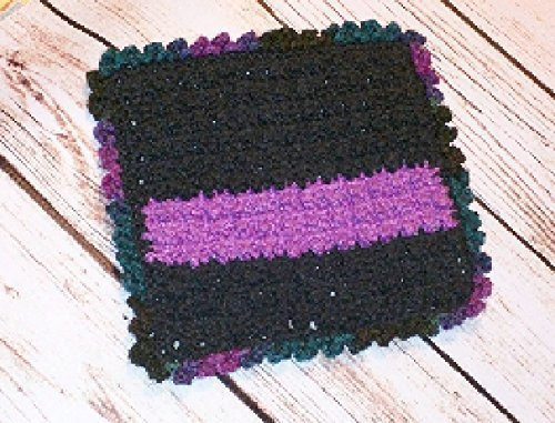 Scrubbing Bobble Dishcloth. Long lasting contemporary black, passion fruit, and violet twilight. Dishcloth crocheted with 100% USA Cotton and unique bobble crochet stitch for extra scrubbing power.