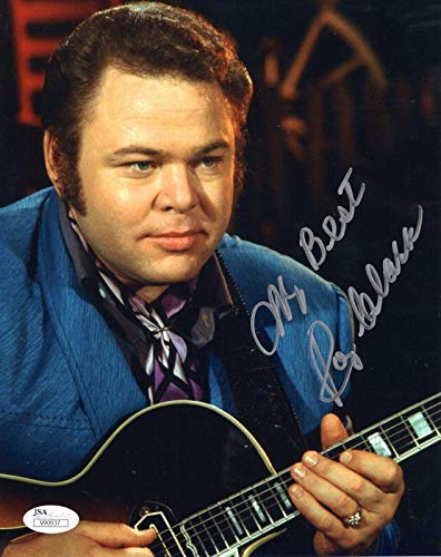 (ROY CLARK HAND SIGNED 8x10 COLOR PHOTO YOUNG POSE WITH HIS GUITAR - JSA)