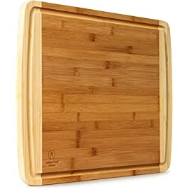 Extra Large Bamboo Cutting Board for Kitchen with Juice Groove - 17.5 x 13.5 x 0.75 inch 94 LOVE OUR CUTTING BOARDS FOR KITCHEN or your money back, Guaranteed! We stand behind our bamboo cutting board 100% If anything is wrong with your heavy duty cutting board Contact Us directly and give us a chance to make it right! 100% SAFE FOR FAMILY! Eco friendly bamboo cutting board with natural antibacterial properties and already coated with food grade mineral oil. Renewable, organic, formaldehyde-free, BPA free, non toxic and no chemicals used during production makes this a perfect choice for your family and the environment. Do Not Place In Dishwasher! KNIFE FRIENDLY! Cutting board won't dull your expensive knife set when you carve turkey, chop vegetables, prep steak meat, roast beef, cooking bbq brisket, slice cheese, cut pizza, fish or other cool food meal stuff. Top choice for cutlery utensil as compared to other noodle, teak, hard plastic or thick hardwood end grain cutting block.