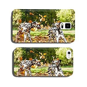 Two dalmatian dogs playing with leaves in autumn cell phone cover case Samsung S6