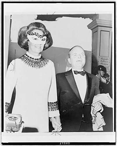 1966 Photo Host of the year / World Journal Tribune photo by Mel Finkelstein. Truman Capote, half-length portrait, facing front, holding hands with Katharine Graham at a masked ball held at the Plaza ()