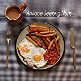 Double Egg With Chips And Beans (And A Tea) by Antique Seeking Nuns (2006-05-04)