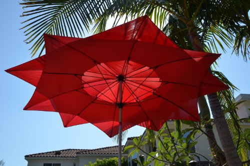8 39 wind resistant lotus fiberglass patio umbrella red for Wind resistant material
