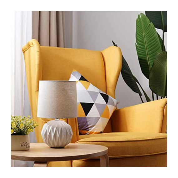 "Tayanuc Small Geometric Ceramic Bedside Nightstand Table Lamp, White Textured Desk Lamp Linen Drum Fabric Shade for Living Room Family Bedroom - Ceramic Table Lamp: This white ceramic table lamp shaped like a pineapple takes a fresh twist with textural geometric ceramic body. The solid color allows the plentiful texture and modern silhouette to truly shine and adds a hint of glam to nightstand. Excellent gifts for the coming Thanksgiving Day. Materials: The inimitable desk lamp will turn heads with its smooth textured curves balanced on a white ceramic base. It is paired with beige linen drum fabric shade that casts an ambient glow. Dimensions: 7.5"" D x 12.6"" H. - lamps, bedroom-decor, bedroom - 51iCMb1jQCL. SS570  -"