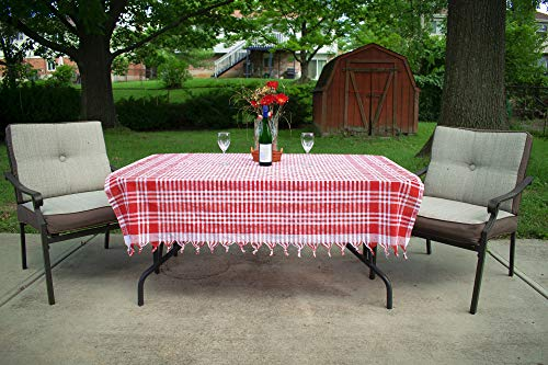 Bohemian picnic blanket used as tablecloth for a patio setting.