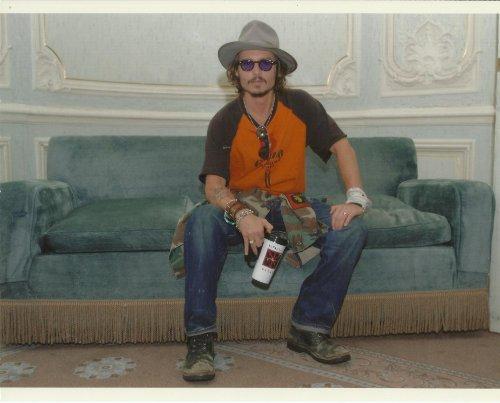 Johnny Depp 8x10 Photo sitting in jeans, t-shirt (Vintage Bracelet Signed)