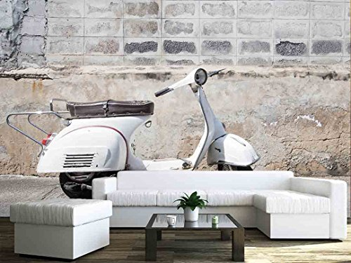 white Classic Vespa scooter stands parked near the concrete old wall