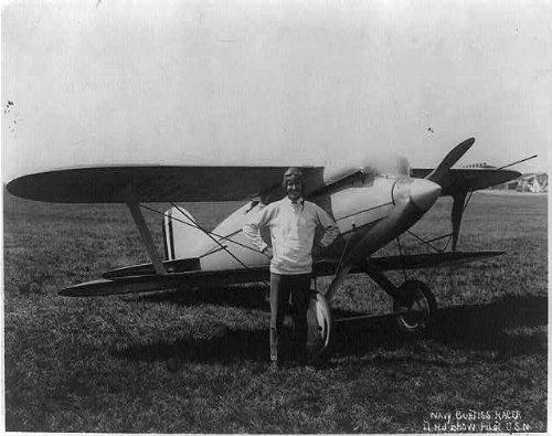 Photo: Lt. H.J. Brow,pilot,U.S.N.,alongside Navy Curtiss Racer airplane,c1920,smiling