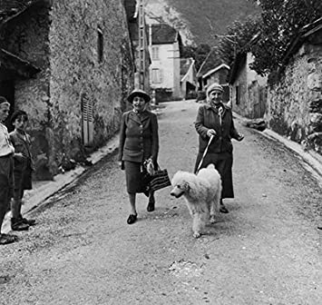 Photo Author Gertrude Stein (R) walking with Alice B. Toklas (L) and their dog. Photographic Archives