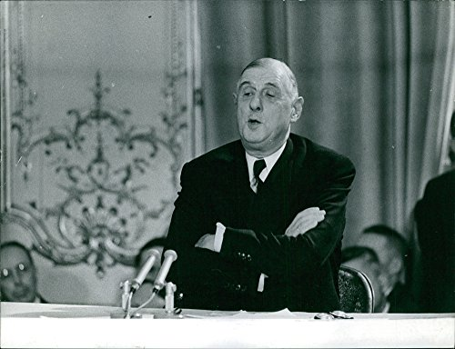 Vintage photo of Charles de Gaulle wraps his arms during his speech at the press conference.