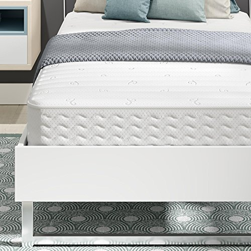 white quilted Signature Sleep Encased Mattress with bedding and pillows in a bedroom