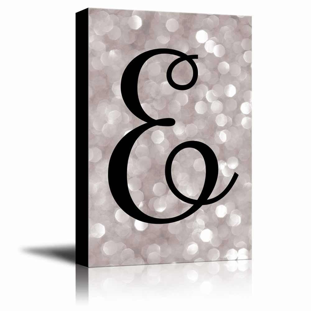 The letter E in brush stroke cursive on a ch&agne colored bokeh background Romantic Elegant Decor