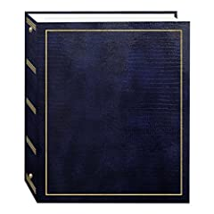 This leatherette cover photo album features gold stamping and Fast-Stick magnetic pages with a clear plastic overlay that self-adheres to the page, securely holding photos. The album's 8.25 x 10.5 inch pages hold many size photos including 2....