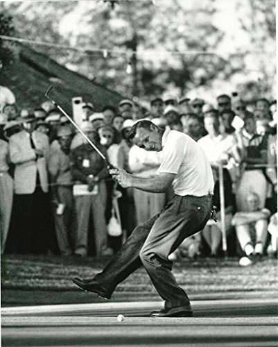 Arnold Palmer sinking a putt during a round of - 11