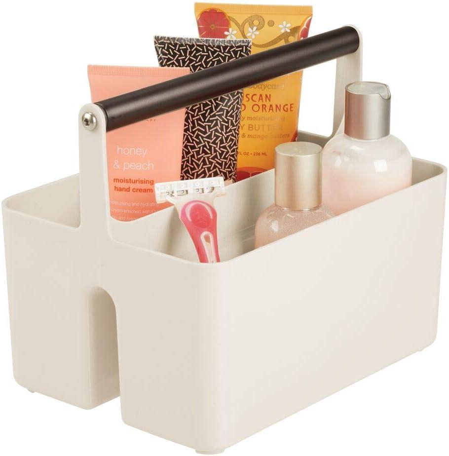 mDesign Caja organizadora para cuarto de baño – Cesta con asa metálica para el almacenamiento de productos cosméticos – Organizador de baño con 2 compartimentos – crema/bronce: Amazon.es: Hogar