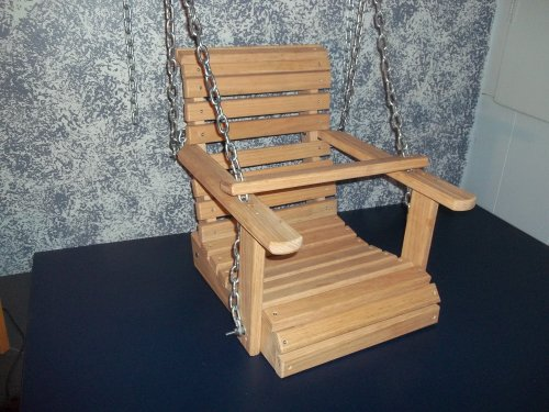 Handcrafted Solid Oak Child Porch Swing. These Wooden Child Porch Swings Will Bring Hours of Laughter to You and Your Child. Add This Wooden Childs Porch Swing to Your Backyard and Start Building Memories While Decorating Your Home Decor! Chain Is Included. Measures 13″ L X 14″ W X 19″ H. The Sitting Part of the Seat Is 14″ Across X 13″ Front to Back. This Swing Is Intended for a Toddler Size Child. Swing Is Unfinished so You Can Finish It to Match Your Decor. Can Easily Be Painted or Would Look Great Plain with Thompson's Water Sealer Applied!