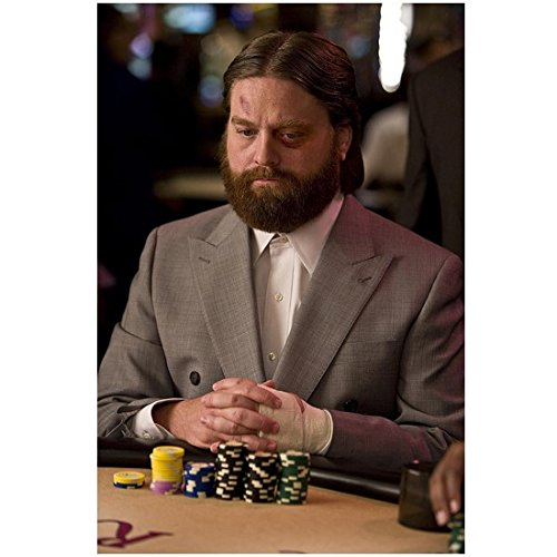 The Hangover 8 inch x 10 inch PHOTOGRAPH Alan with Black and Blue Face Hand in Bandage Grey Blazer White Dress Shirt Sitting at Casino Table with Piles of Chips in Front of Him Mid D