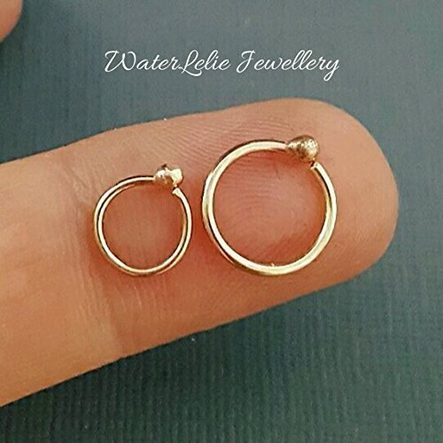 2dc1e745e Amazon.com: Tiny 10k Gold nose ring. Genuine gold nose ring. 10K ...