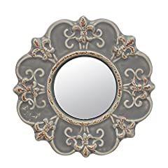 This worn gray ceramic mirror is part of The Stonebriar Parisian Market Collection boasting elements of ranch architecture, symbology, and antiques that mix with weathered metals and hints of turquoise pale ocean, and amber to bring a ...