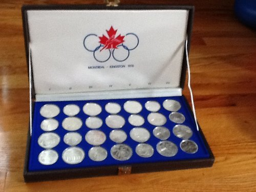 1976 Commemorative Set 1976 Montreal Olympics. Made by the Royal Canadian Mint Perfect Uncirculated (Royal Canadian Mint Coin Sets)