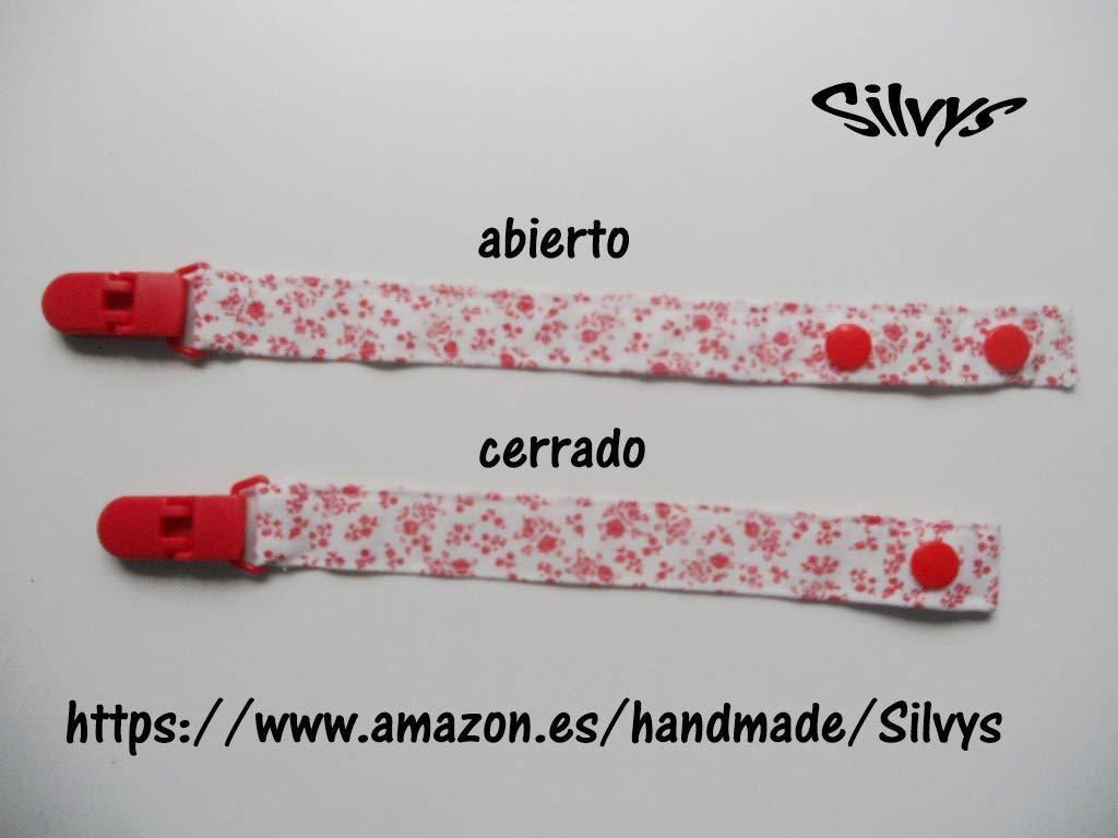 Chupetero de tela con clip Silvys para bebé. Blanco con flores rojas ...